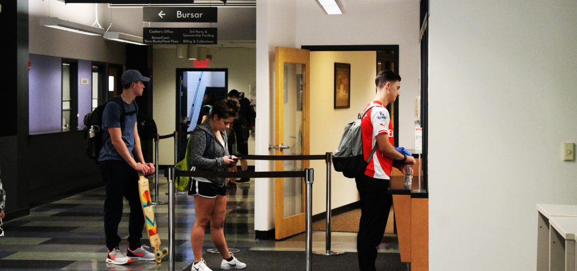 students wait in line for Financial Aid office