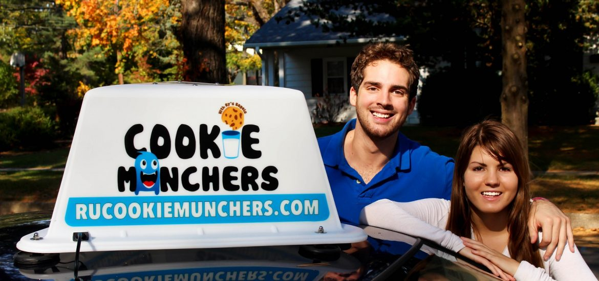 """Cassie Aran and Brandon Lucante pose with their new car sign for """"Cookie Munchers"""""""