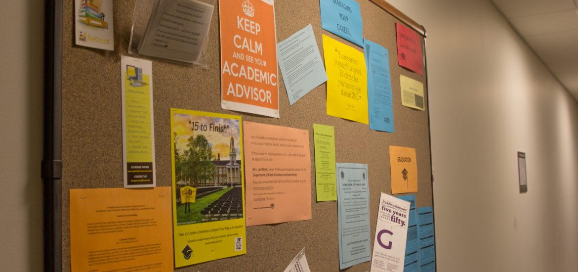 colorful fliers on a bulletin board