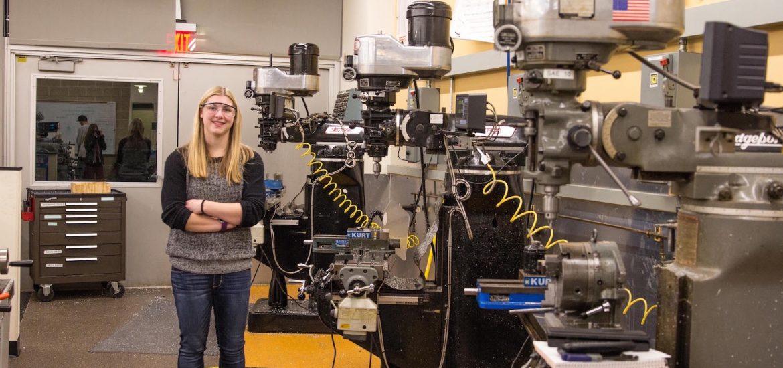biomedical engineering major Haley stands in a workshop lab