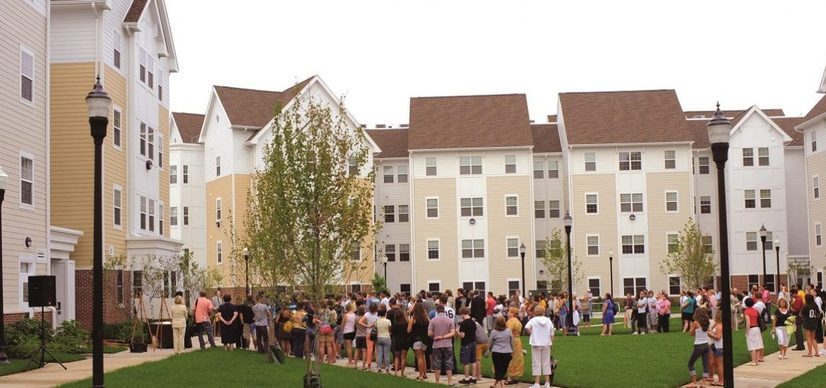 people stand outside of Rowan Boulevard Apartments