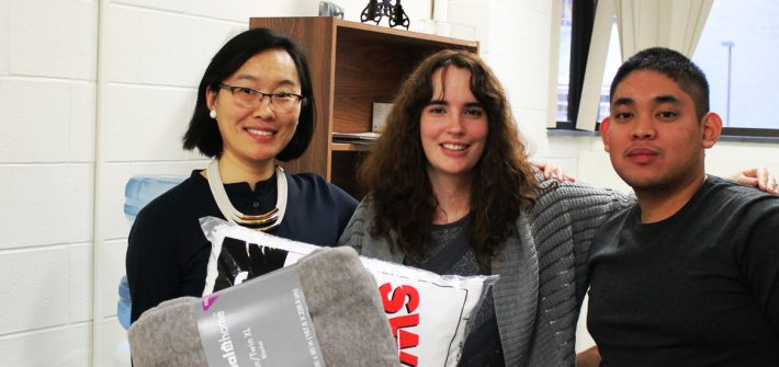 Dr. Li Yang, Katelyn Sullivan and Arthur Bautista at the International Center