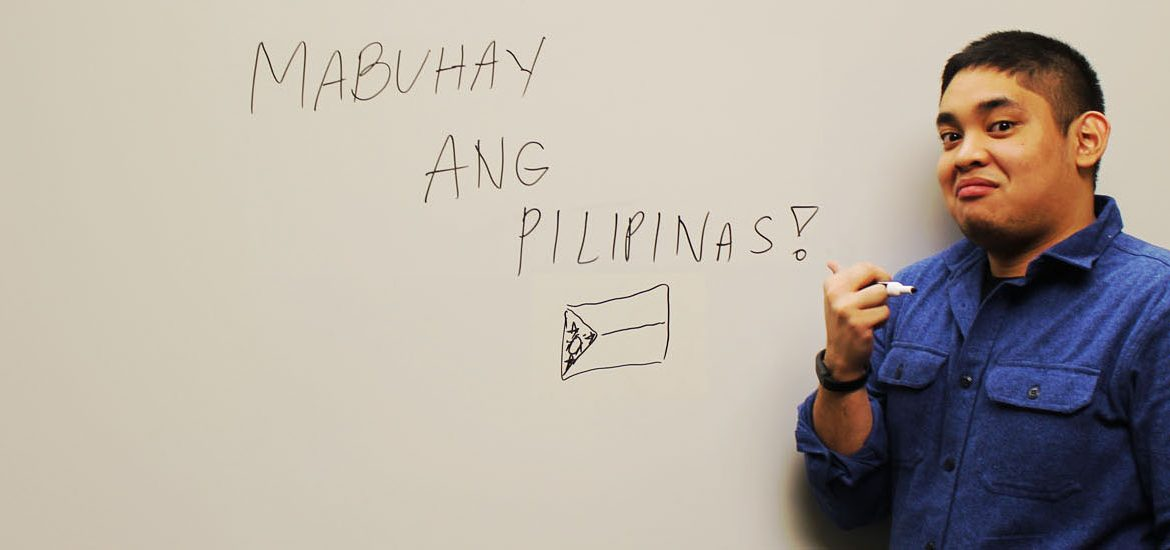 Political Science Major Andrew Bautista poses in a new Business Hall at Rowan University