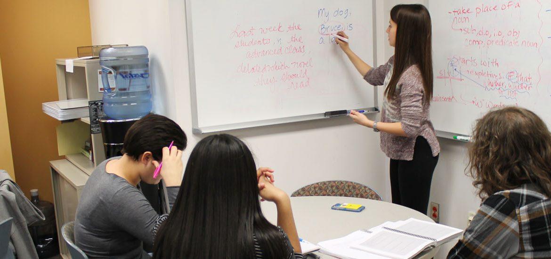 A tutor teaches three tutees at Rowan Tutoring Center
