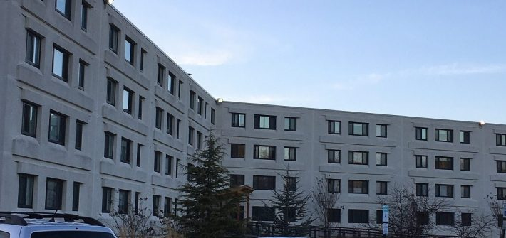 concrete exterior of Triad apartments
