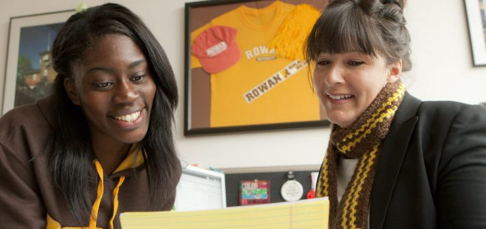academic advisor at Rowan University sits with a student to review her schedule