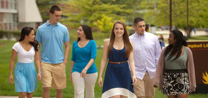 Rowan University students walking outside of Campbell Library