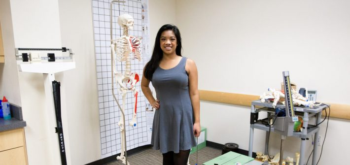 Nikki stationed with physical therapy equipment