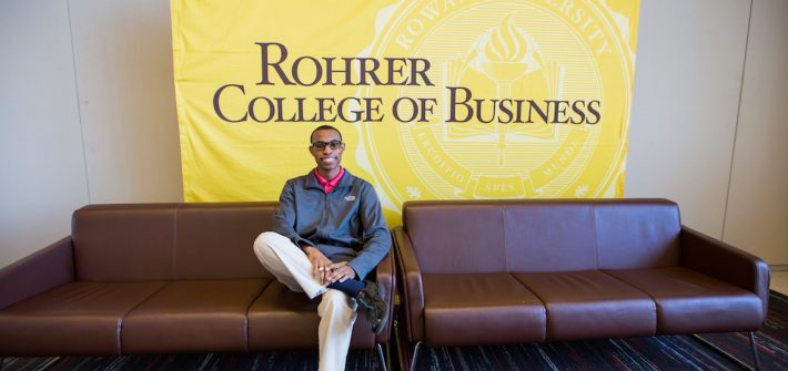 Davon sitting on the couch inside the Rohrer Business of college at Rowan University in Glassboro NJ