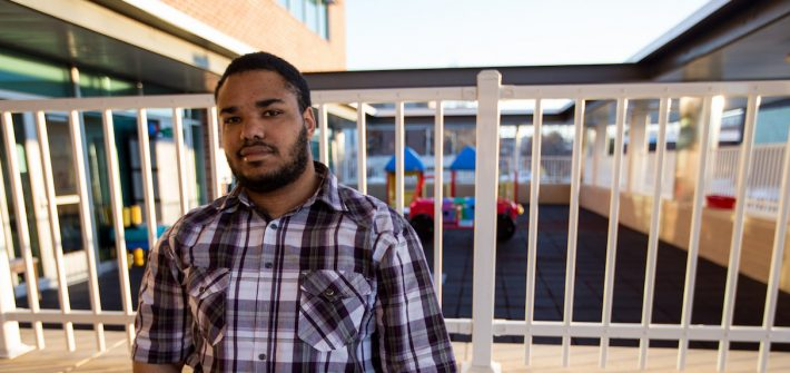 Darius outside Rowan playground at Early Childhood Demonstration Center at James Hall
