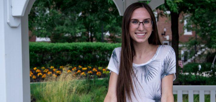 Molly, a transfer student, standing in a gazebo near Bunce.
