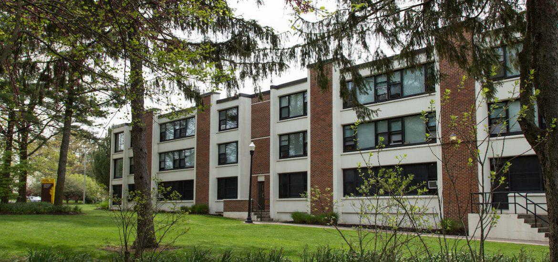 rowan university evergreen hall with greenery