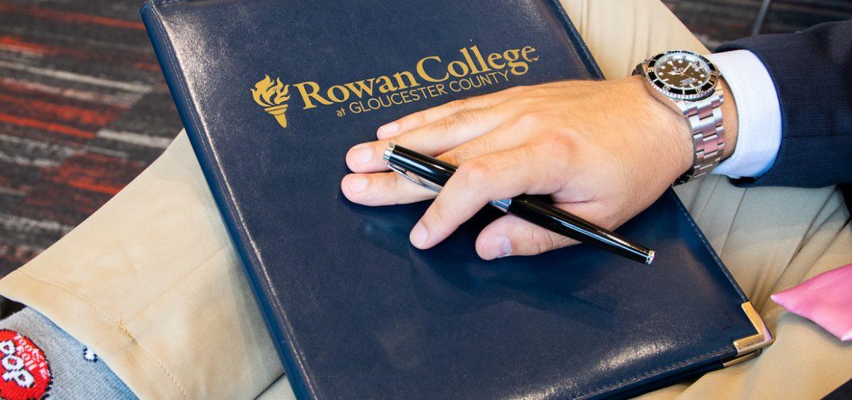 business folder and student at Rowan University