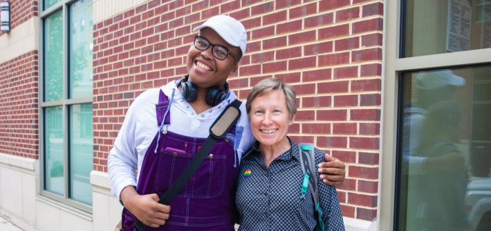 Student and teacher outside rowan Blvd