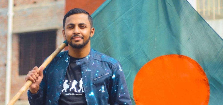 Sha holding a flag outside