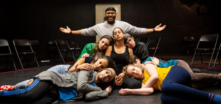 Kerry and cast on the stage in the blackbox theater at rehearsal