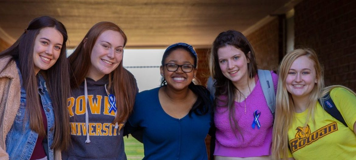 Hajah and four friends stand in the underpass at Willow Hall.