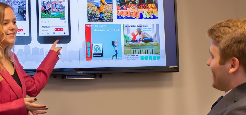 kailey and tim of rowan university review their award-winning presentation