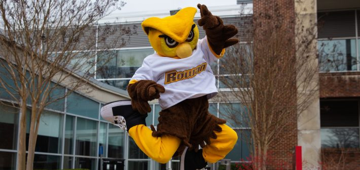 mascot Whoo RU jumps for joy and is seen mid-air