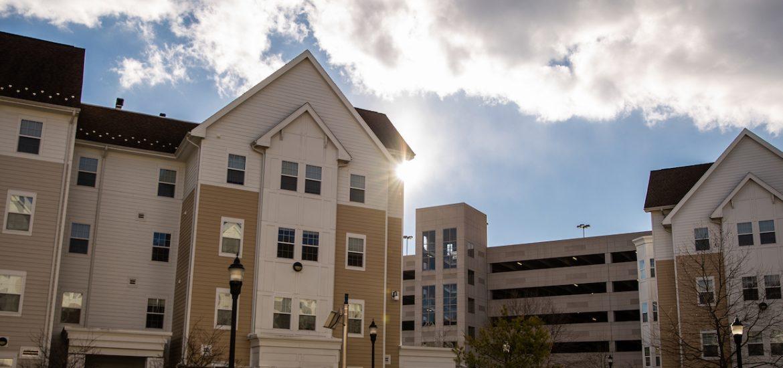 Robo apartments outside with the sun shining through