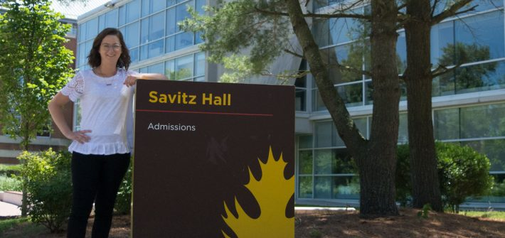Rowan admissions officer Amanda Kuster standing outside of Savitz Hall