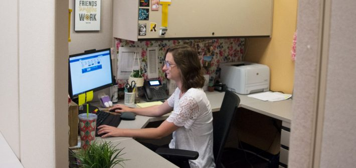 Rowan admissions officer Amanda Kuster working at her desk in Savitz Hall
