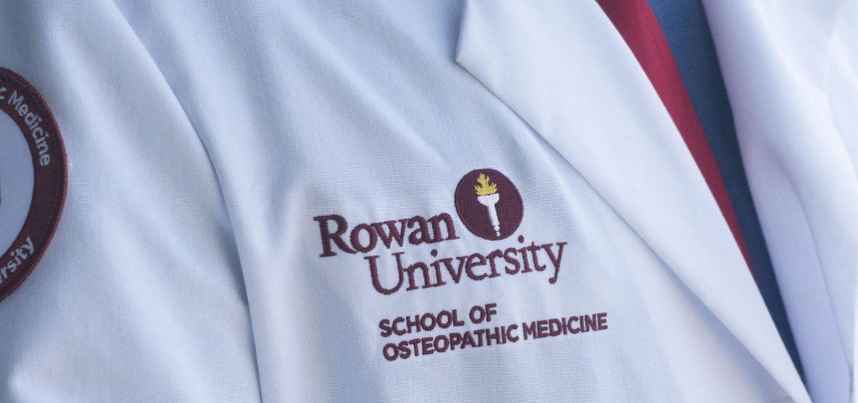 "Lab coat of Nathan Carroll labeled ""Rowan University: School of Osteopathic Medicine"""