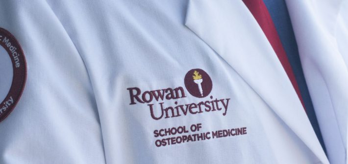 "Lab coat of Nathan Carroll labeled ""Rowan University: School of Osteopathic Medicine"""
