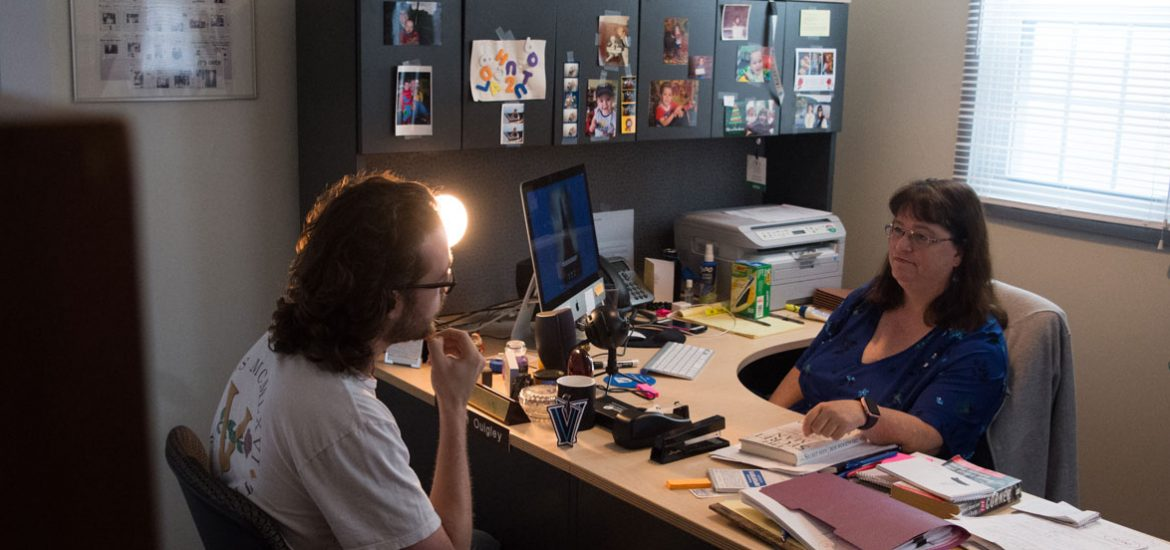 Professor Quigley and a student sit in her office during a meeting