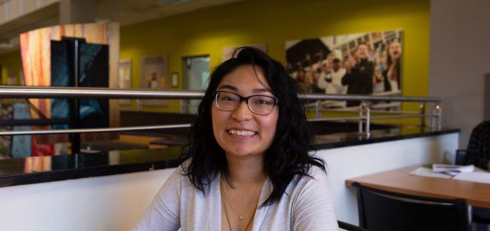 Bioinformatics major Anne Marie Fernandez photographed inside Chamberlain Student Center