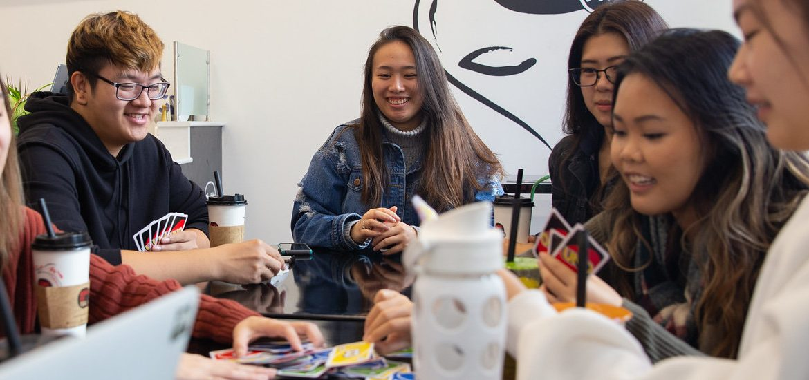 Brianna Nghiem and members of the Vietnamese Student Association hang out on Rowan Boulevard