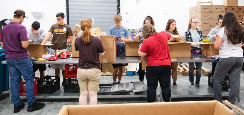 students sorting food at the south jersey food bank