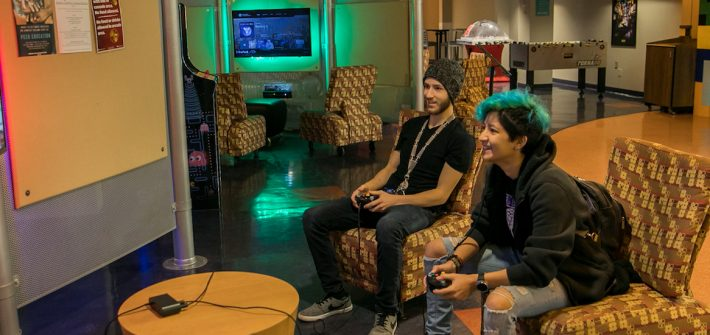Matt and his friend play Super Smash Bros in the Game Room.