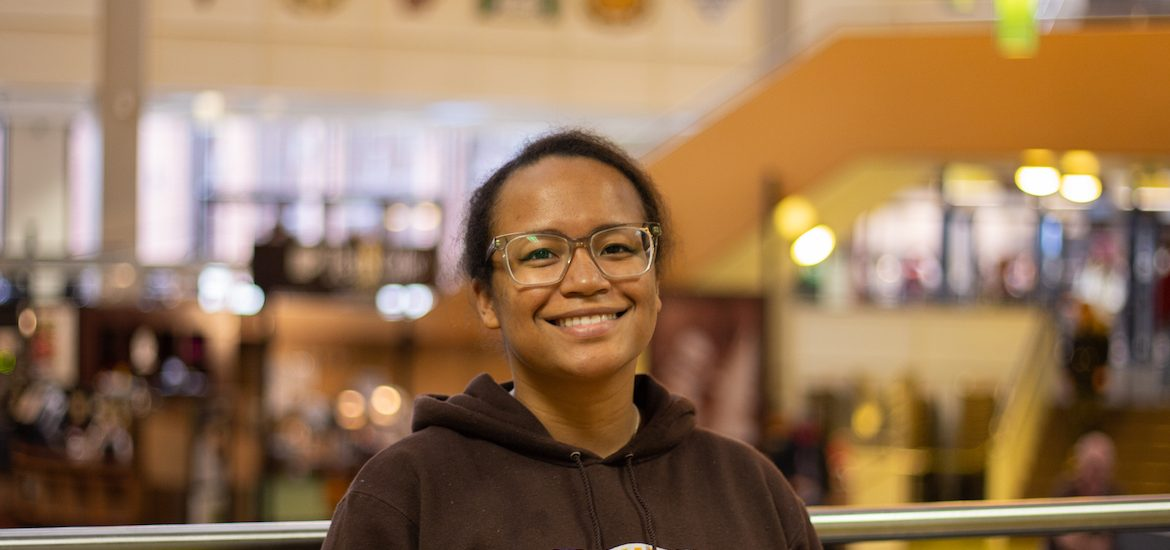 Autumn smiles at the camera for a portrait taken in the student center.