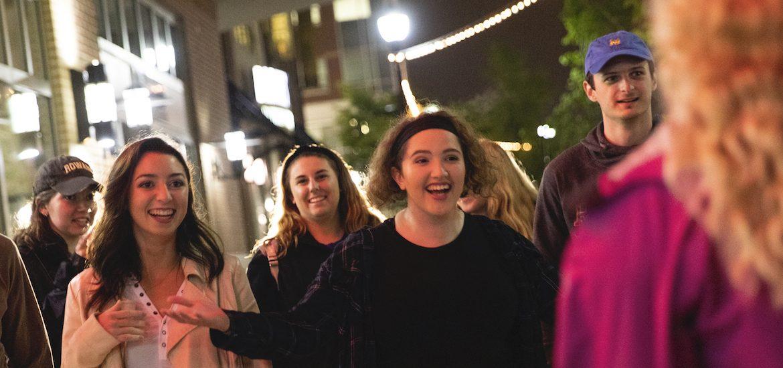 Bianca and friends happily greet a friend on Rowan Boulevard.