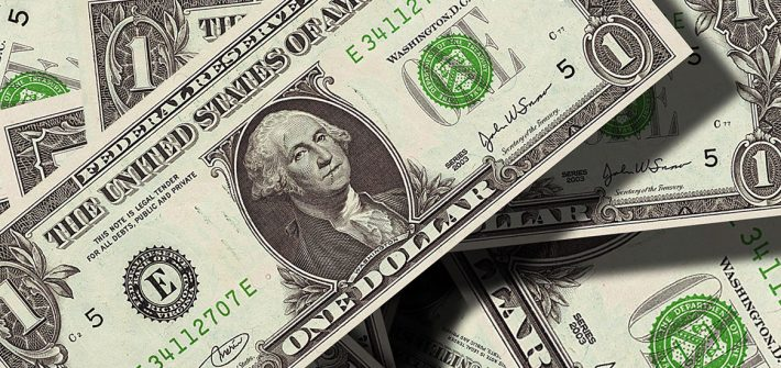 Scattered dollar bills.