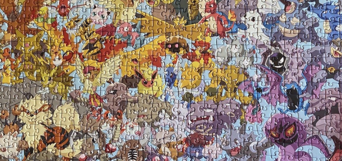 Close up of a completed multi-colored Pokemon puzzle.