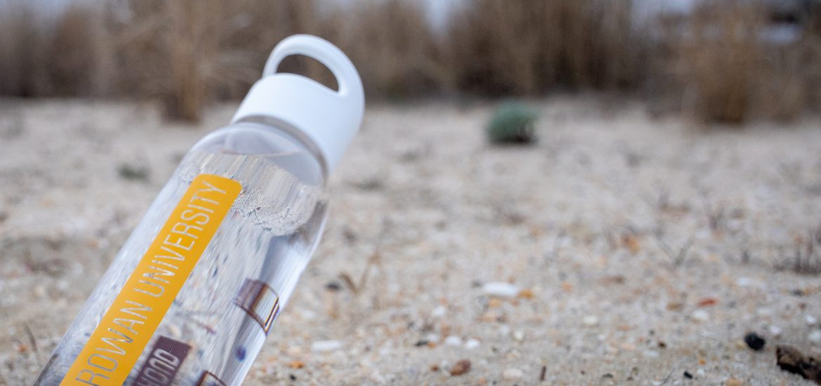 rowan university water bottle on the beach