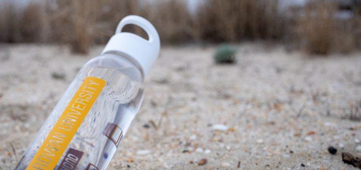rowan university water bottle on the beach