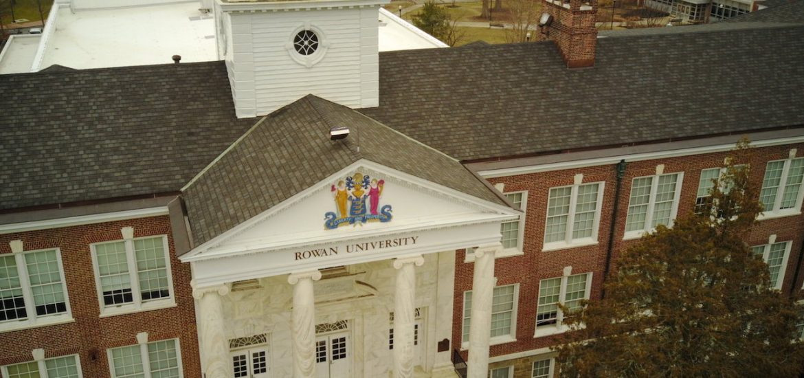 Drone view of brick and white columns of Bunce Hall.