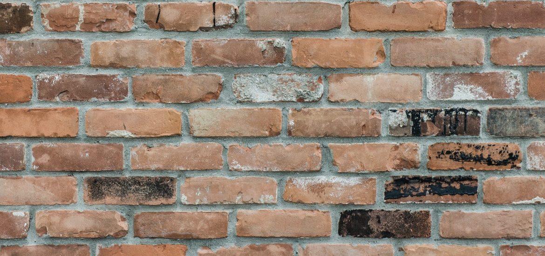 Stock image of mixed color reddish brick.