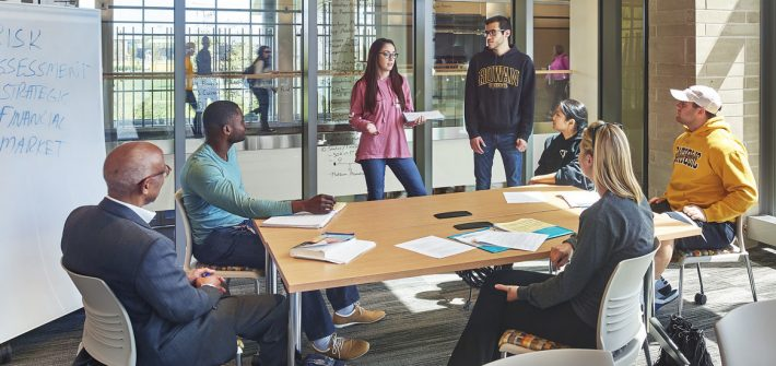Rowan students discuss a business plan in the Rohrer College of Business.