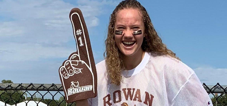 Bella wearing Rowan gear with a foam Rowan finger.