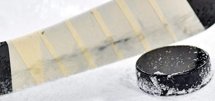 Stock image of a hockey stick and puck