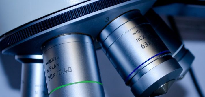 Stock image of a close up of a microscope.