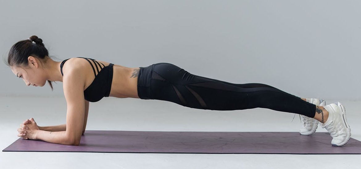 stock image of woman planking
