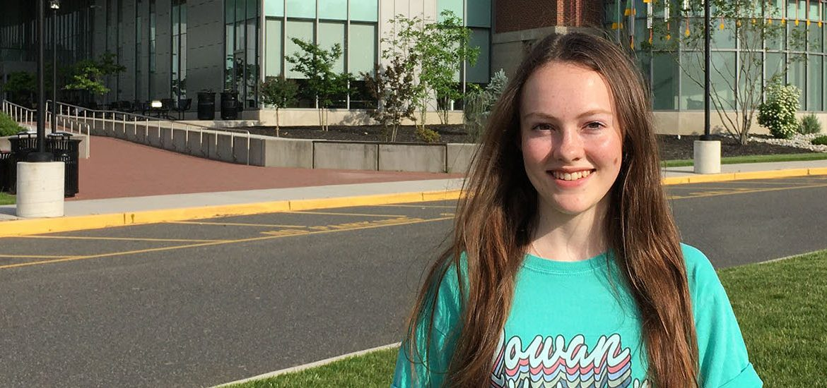 Lily stands in front of Business Hall.
