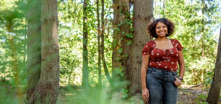 Destiny Hall standing a fall forest.