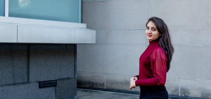 Niyati standing outside.
