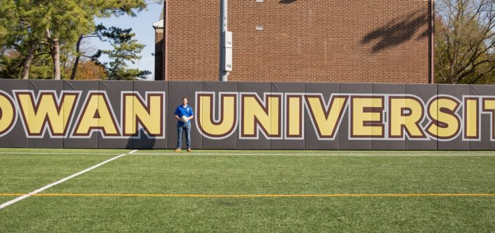 Chase poses on the intramural field at Rowan.
